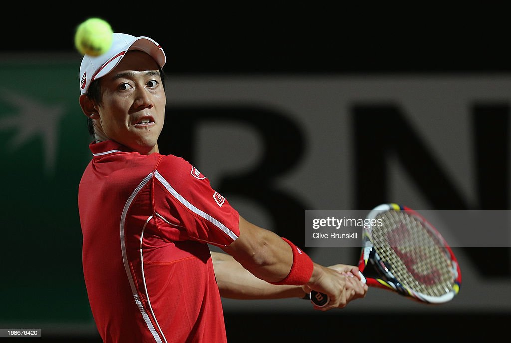 Kei Nishikori of Japan plays a backhand against Paolo Lorenzi of Italy in their first round match during day two of the Internazionali BNL d'Italia 2013 at the Foro Italico Tennis Centre on May 13, 2013 in Rome, Italy.