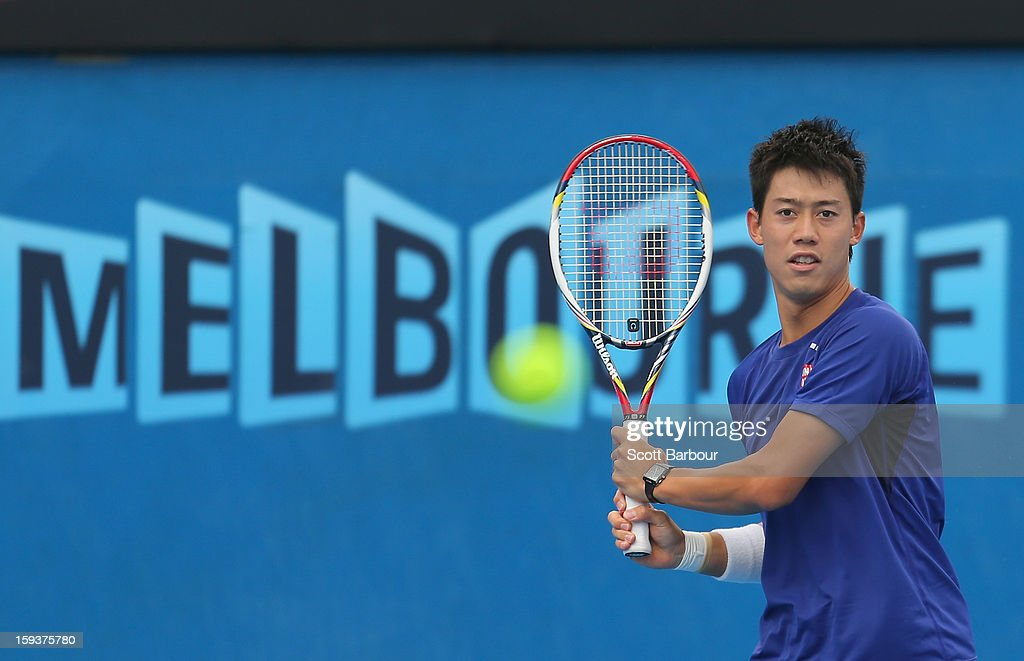 Kei Nishikori of Japan plays a backhand during a practice session ahead of the 2013 Australian Open at Melbourne Park on January 13, 2013 in Melbourne, Australia.