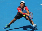 Kei Nishikori of Japan plays a backhand during his match against Tomas Berdych of the Czech Republic during day four of the AAMI Classic at Kooyong...