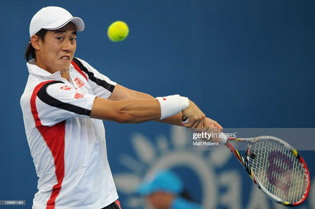 Kei Nishikori of Japan plays a backhand during his semi final match against Andy Murray of Great Britain on day seven of the Brisbane International at Pat Rafter Arena on January 5, 2013 in Brisbane, Australia.