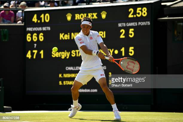 Kei Nishikori of Japan plays a backhand during the Gentlemen's Singles second round match against Sergiy Stakhovsky of Ukraine on day three of the...