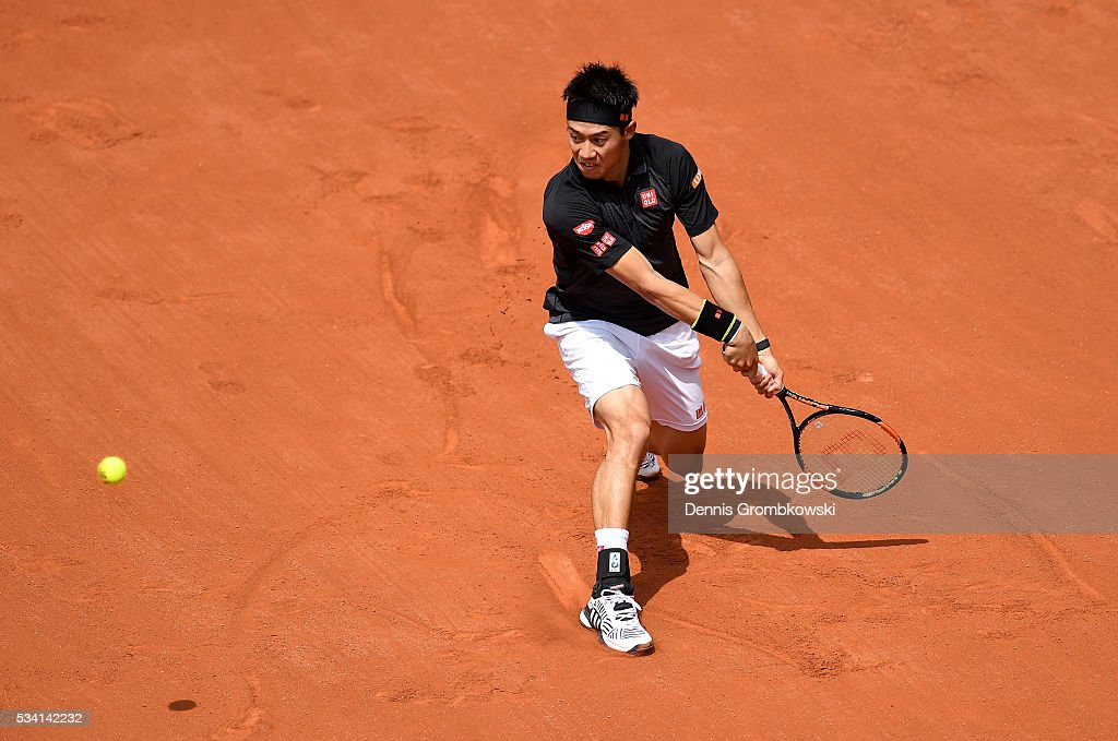 <a gi-track='captionPersonalityLinkClicked' href=/galleries/search?phrase=Kei+Nishikori&family=editorial&specificpeople=4432498 ng-click='$event.stopPropagation()'>Kei Nishikori</a> of Japan plays a backhand during the Men's Singles second round match against Andrey Kuznetsov of Russia at Roland Garros on May 25, 2016 in Paris, France.