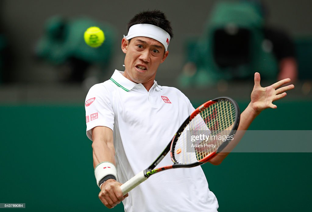 Kei Nishikori of Japan plays a backhand during the Men's Singles second round match against Julien Benneteau of France on day four of the Wimbledon Lawn Tennis Championships at the All England Lawn Tennis and Croquet Club on June 30, 2016 in London, England.