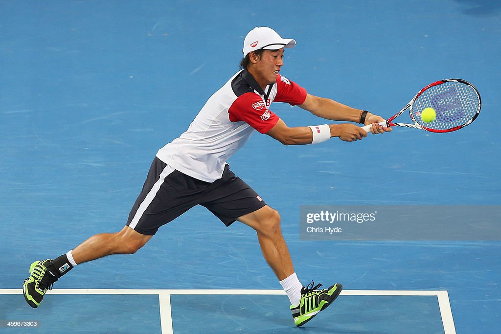 <a gi-track='captionPersonalityLinkClicked' href=/galleries/search?phrase=Kei+Nishikori&family=editorial&specificpeople=4432498 ng-click='$event.stopPropagation()'>Kei Nishikori</a> of Japan plays a backhand in his doubles match with doubles partner Sam Querrey of the USA against Marinko Matosevic of Australia and Dmitry Tursunov of Russia during day one of the 2014 Brisbane International at Queensland Tennis Centre on December 29, 2013 in Brisbane, Australia.