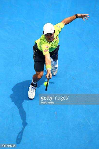 Kei Nishikori of Japan plays a backhand in his first round match against Nicolas Almagro of Spain during day two of the 2015 Australian Open at...