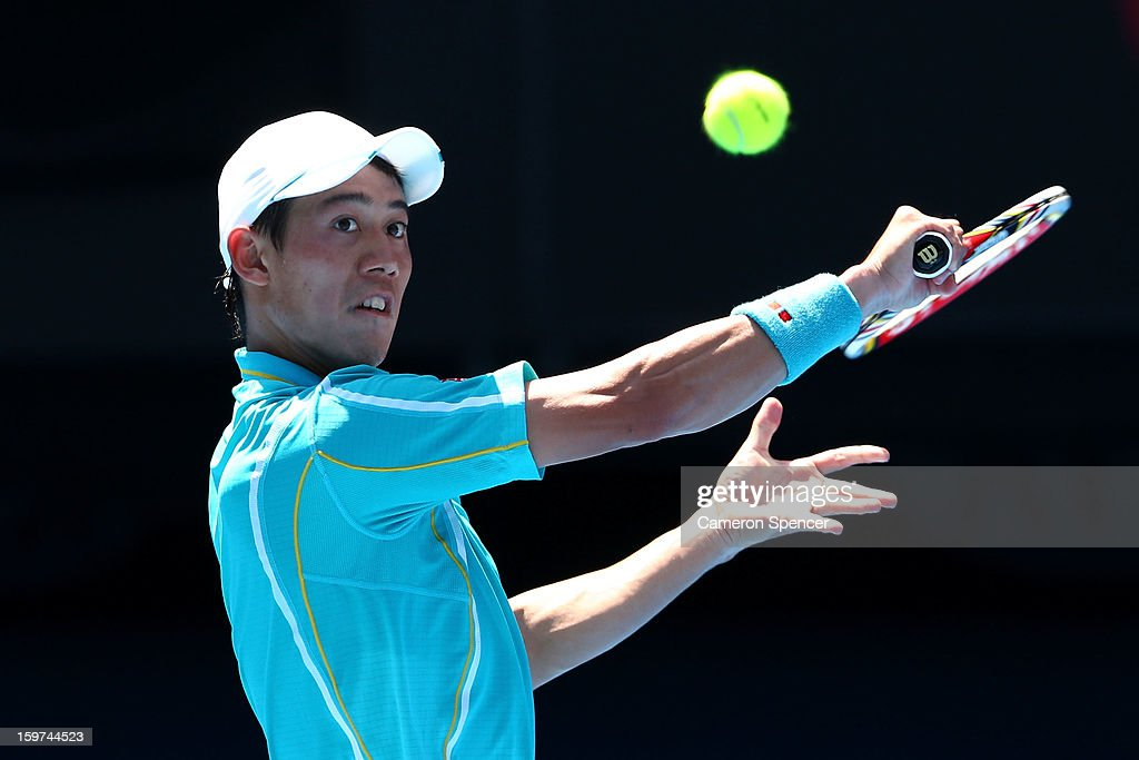 Kei Nishikori of Japan plays a backhand in his fourth round match against David Ferrer of of Spain during day seven of the 2013 Australian Open at Melbourne Park on January 20, 2013 in Melbourne, Australia.
