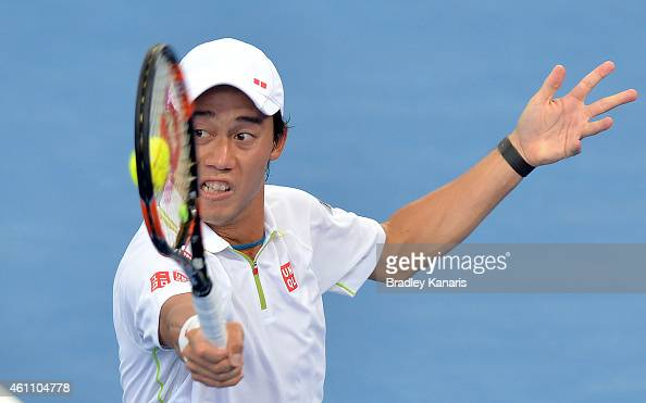 Kei Nishikori of Japan plays a backhand in his match against Steve Johnson of the USA during day four of the 2015 Brisbane International at Pat...