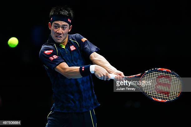 Kei Nishikori of Japan plays a backhand in his men's singles match against Tomas Berdych of Czech Republic during day three of the Barclays ATP World...