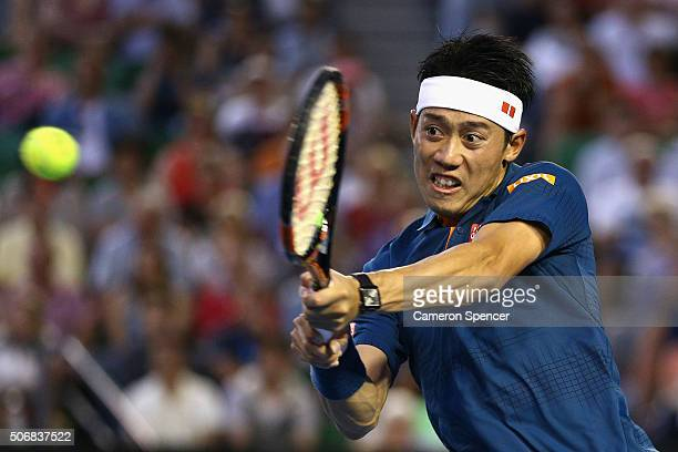Kei Nishikori of Japan plays a backhand in his quarter final match against Novak Djokovic of Serbia during day nine of the 2016 Australian Open at...