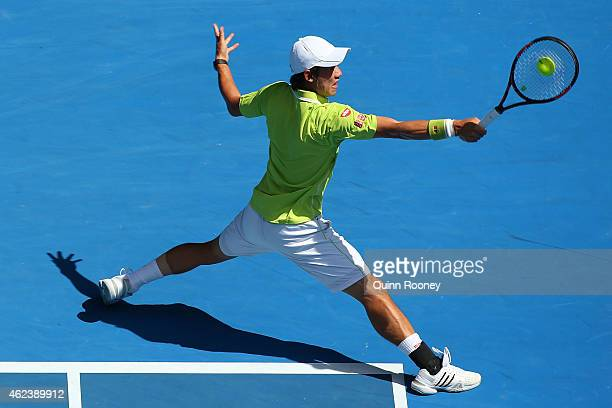 Kei Nishikori of Japan plays a backhand in his quarterfinal match against Stanislas Wawrinka of Switzerland during day 10 of the 2015 Australian Open...