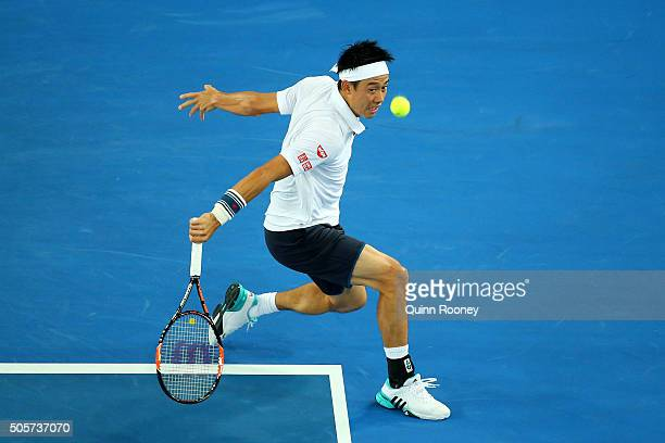 Kei Nishikori of Japan plays a backhand in his second round match against Austin Krajicek of the United States during day three of the 2016...