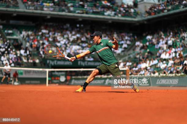 Kei Nishikori of Japan plays a backhand shot during his match with Andy Murray of Great Britain on day eleven at Roland Garros on June 7 2017 in...