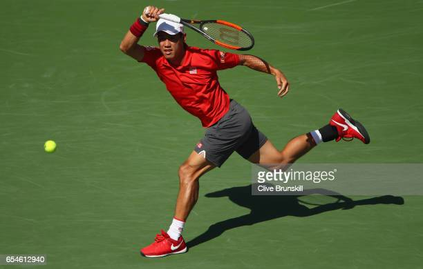 Kei Nishikori of Japan plays a forehand against Jack Sock of the United States in their quarter final match during day twelve of the BNP Paribas Open...