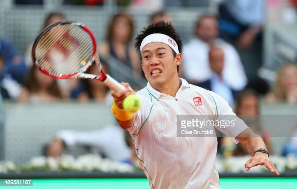Kei Nishikori of Japan plays a forehand against Rafael Nadal of Spain in their final match during day nine of the Mutua Madrid Open tennis tournament...