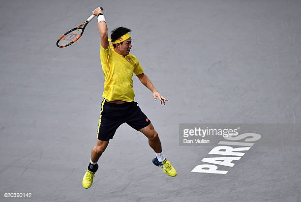 Kei Nishikori of Japan plays a forehand against Viktor Troicki of Serbia during the Mens Singles second round match on day three of the BNP Paribas...
