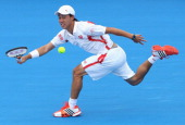 Kei Nishikori of Japan plays a forehand during his match against JoWilfried Tsonga of France during day two of the 2012 Kooyong Classic at Kooyong on...