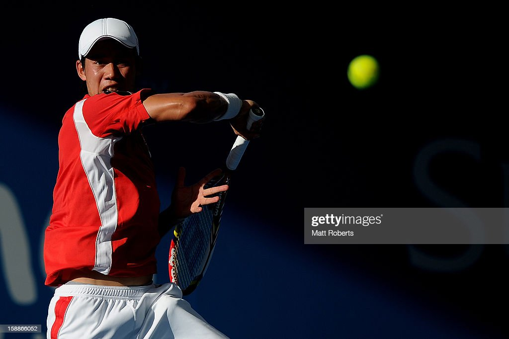 Kei Nishikori of Japan plays a forehand during his match against Tommy Robredo of Spain day four of the Brisbane International at Pat Rafter Arena on January 2, 2013 in Brisbane, Australia.