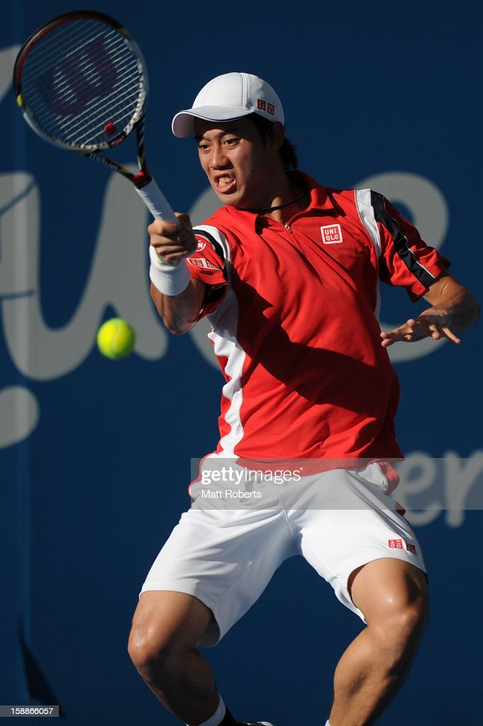 Kei Nishikori of Japan plays a forehand during his match against Tommy Robredo of Spain on day four of the Brisbane International at Pat Rafter Arena on January 2, 2013 in Brisbane, Australia.