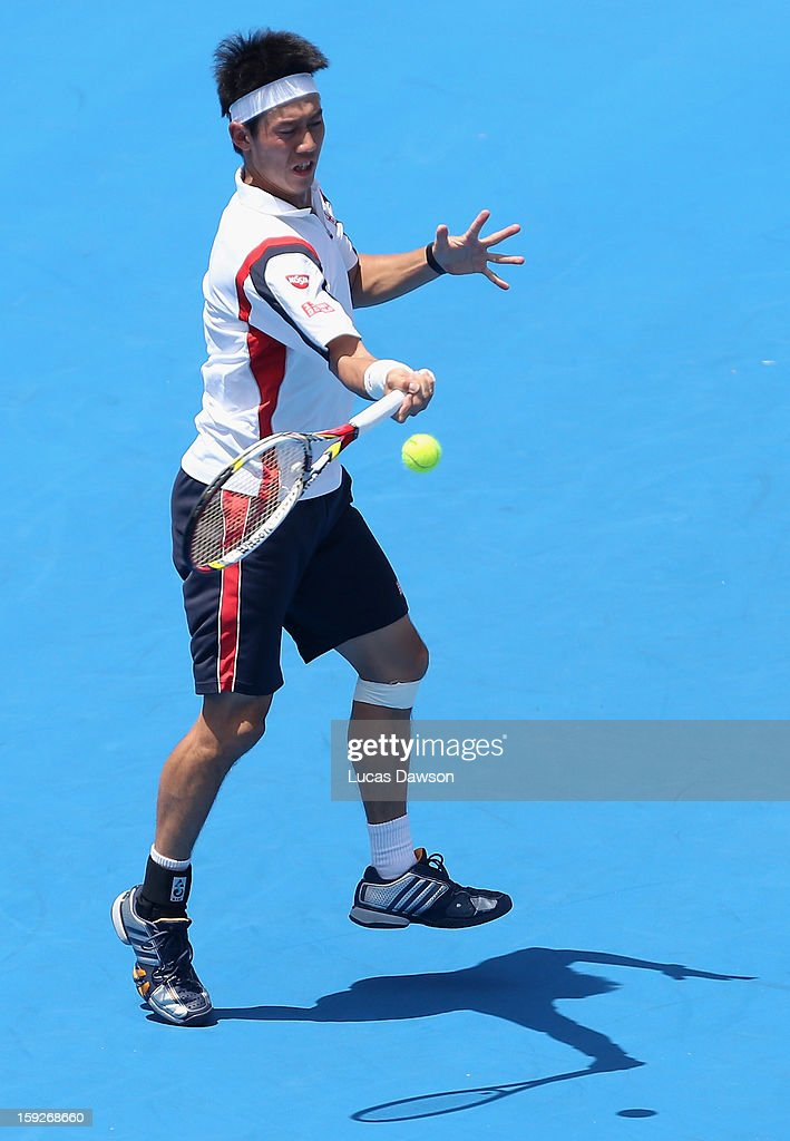 Kei Nishikori of Japan plays a forehand during his match against Paul-Henri Mathieu of France during day three of the AAMI Classic at Kooyong on January 11, 2013 in Melbourne, Australia.