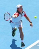 Kei Nishikori of Japan plays a forehand during his match against Tomas Berdych of the Czech Republic during day two of the AAMI Classic at Kooyong on...