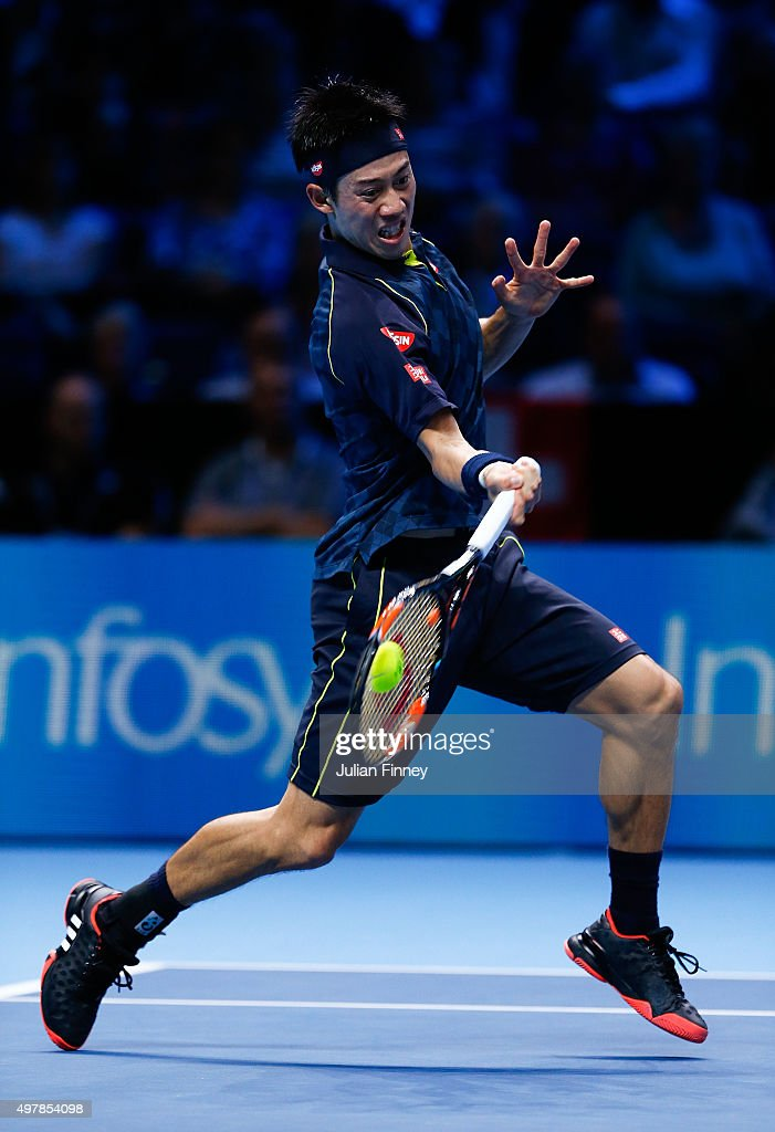 Kei Nishikori of Japan plays a forehand during his men's singles match against Roger Federer of Switzerland during day five of the Barclays ATP World Tour Finals at the O2 Arena on November 19, 2015 in London, England.