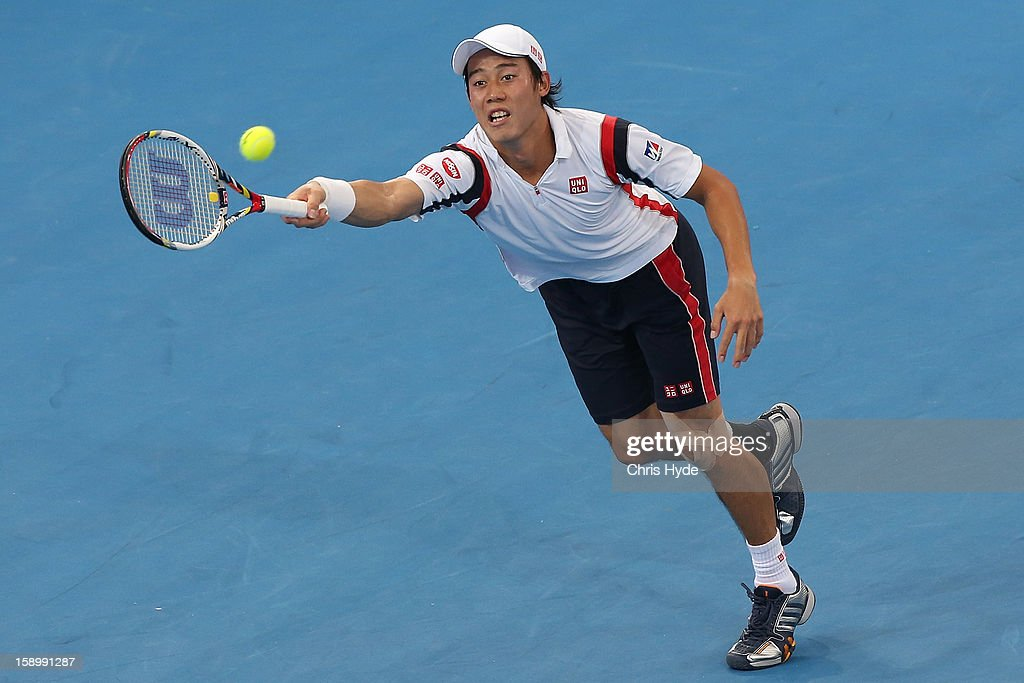 Kei Nishikori of Japan plays a forehand during his semi final match against Andy Murray of Great Britain during day seven of the Brisbane International at Pat Rafter Arena on January 5, 2013 in Brisbane, Australia.