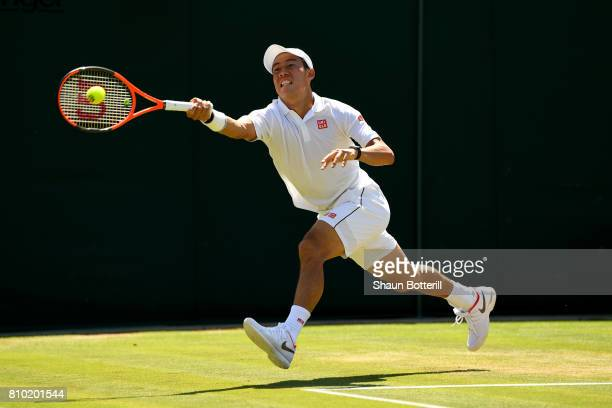 Kei Nishikori of Japan plays a forehand during the Gentlemen's Singles third round match against Roberto Bautista Agut of Spain on day five of the...