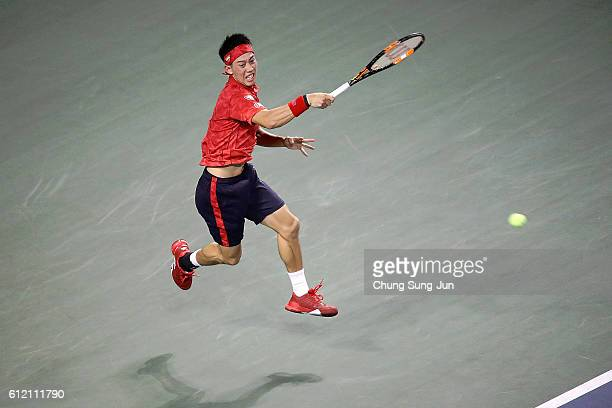 Kei Nishikori of Japan plays a forehand during the men's singles first round match against Donald Young of USA on day one of Rakuten Open 2016 at...