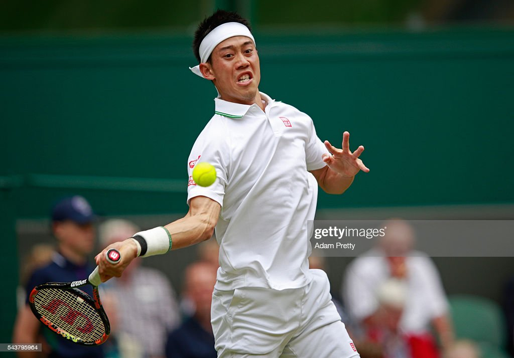 Kei Nishikori of Japan plays a forehand during the Men's Singles second round match against Julien Benneteau of France on day four of the Wimbledon Lawn Tennis Championships at the All England Lawn Tennis and Croquet Club on June 30, 2016 in London, England.