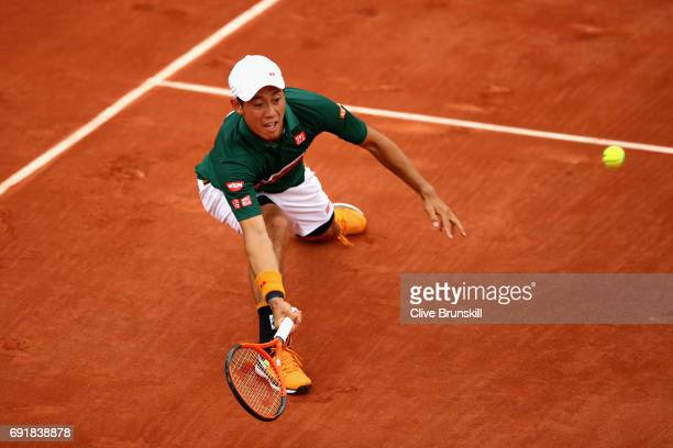 Kei Nishikori of Japan plays a forehand during the mens singles third round match against Hyeon Chung of Korea on day seven of the 2017 French Open...