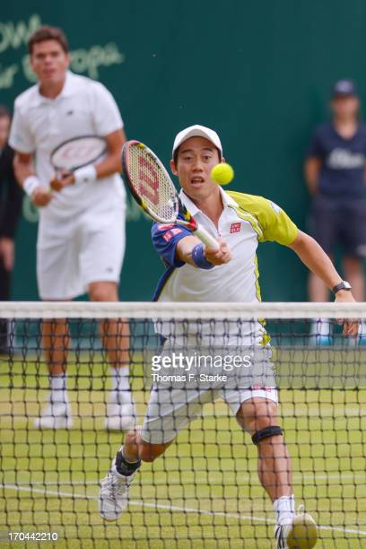 Kei Nishikori of Japan plays a forehand in his doubles match with Milos Raonic of Canada against Philipp Kohlschreiber of Germany and Mikhail Youzhny...