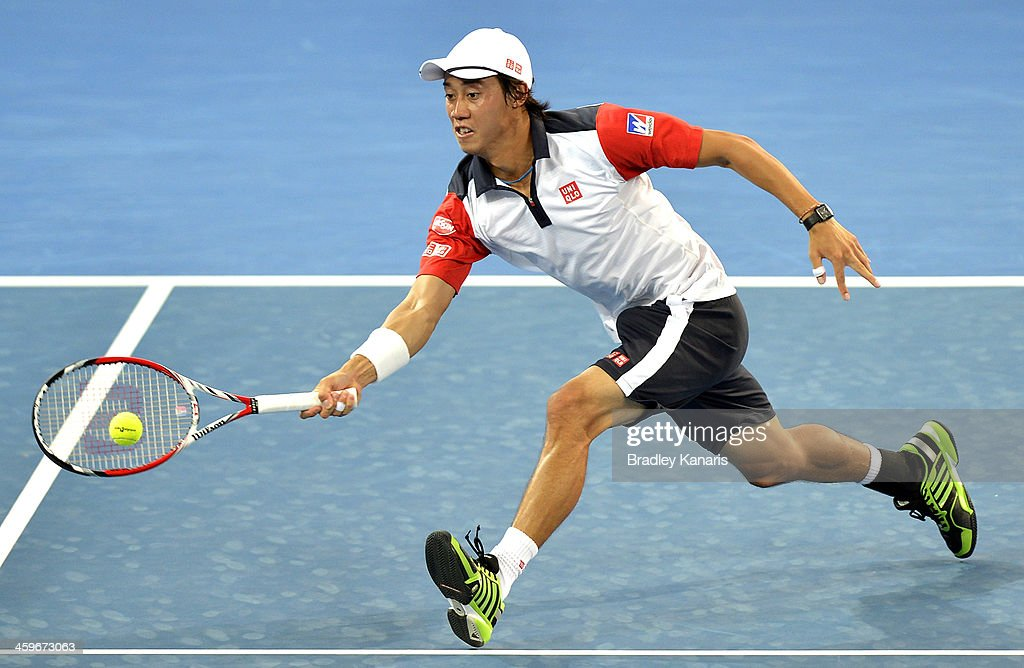 <a gi-track='captionPersonalityLinkClicked' href=/galleries/search?phrase=Kei+Nishikori&family=editorial&specificpeople=4432498 ng-click='$event.stopPropagation()'>Kei Nishikori</a> of Japan plays a forehand in his doubles match with doubles partner Sam Querrey of the USA against Marinko Matosevic of Australia and Dmitry Tursunov of Russia during day one of the 2014 Brisbane International at Queensland Tennis Centre on December 29, 2013 in Brisbane, Australia.