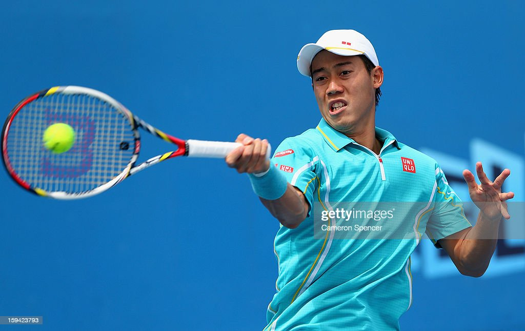 Kei Nishikori of Japan plays a forehand in his first round match against Victor Hanescu of Romania during day one of the 2013 Australian Open at Melbourne Park on January 14, 2013 in Melbourne, Australia.