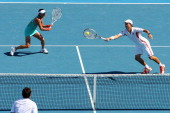 Kei Nishikori of Japan plays a forehand in his first round mixed doubles match with Kimiko DateKrumm of Japan against Gisla Dulko and Eduardo Schwank...