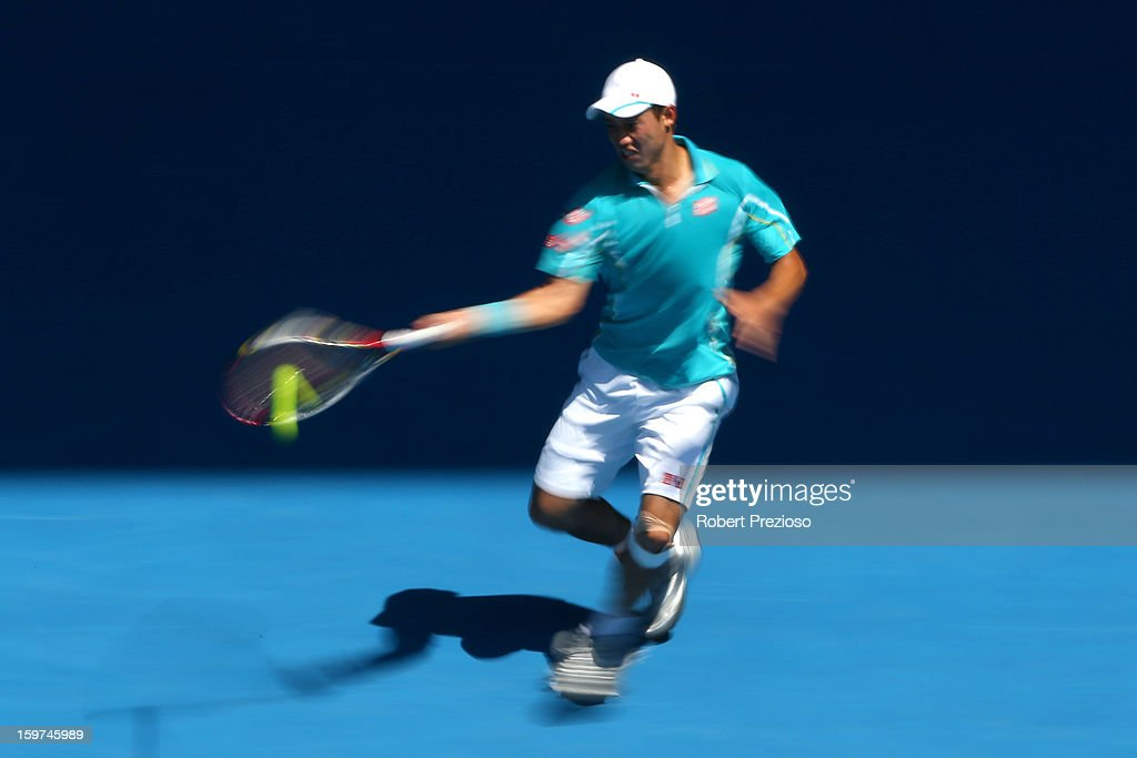 Kei Nishikori of Japan plays a forehand in his fourth round match against David Ferrer of of Spain during day seven of the 2013 Australian Open at Melbourne Park on January 20, 2013 in Melbourne, Australia.
