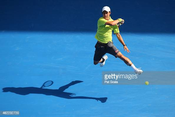 Kei Nishikori of Japan plays a forehand in his fourth round match against David Ferrer of Spain during day eight of the 2015 Australian Open at...