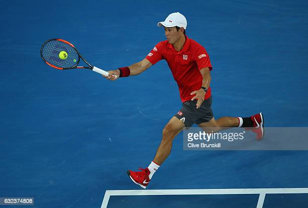 Kei Nishikori of Japan plays a forehand in his fourth round match against Roger Federer of Switzerland on day seven of the 2017 Australian Open at...