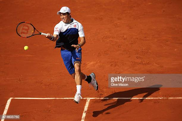 Kei Nishikori of Japan plays a forehand in his Men's Singles match against PaulHenri Mathieu of France on day one of the 2015 French Open at Roland...