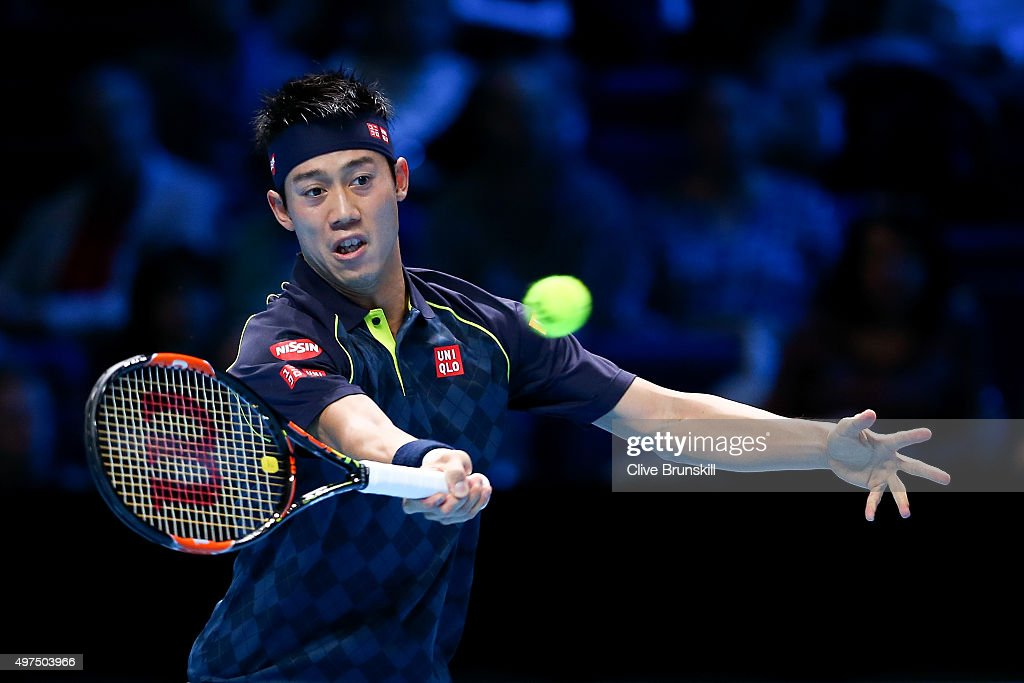 Kei Nishikori of Japan plays a forehand in his men's singles match against Tomas Berdych of Czech Republic during day three of the Barclays ATP World Tour Finals at the O2 Arena on November 17, 2015 in London, England.