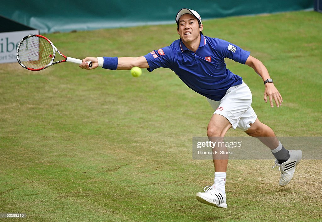 Kei Nishikori of Japan plays a forehand in the half final match against Roger Federer of Switzerland during day six of the Gerry Weber Open at Gerry...