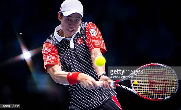 Kei Nishikori of Japan plays a forehand in the round robin singles match against David Ferrer of Spain on day five of the Barclays ATP World Tour...
