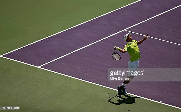 Kei Nishikori of Japan plays a match against Mikhail Youzhny of Russia during Day 6 of the Miami Open presented by Itau at Crandon Park Tennis Center...