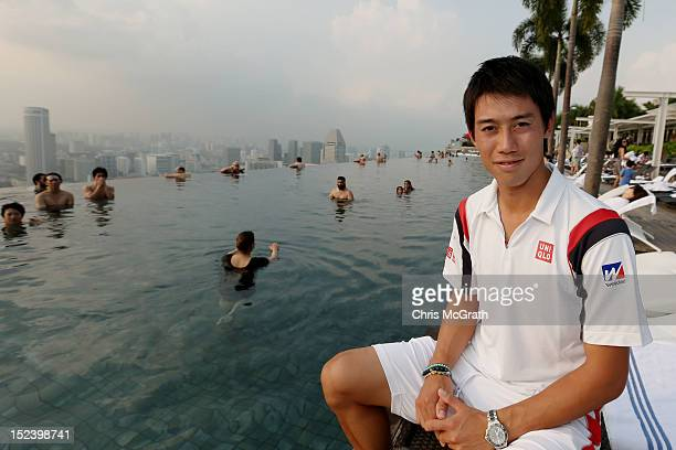 Kei Nishikori of Japan poses for a portrait at the Infinity Pool at Marina Bay Sands during the ATP World Tour Asian Tour on September 20 2012 in...