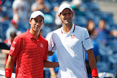 Kei Nishikori of Japan poses with Novak Djokovic of Serbia prior to their men's singles semifinal match on Day Thirteen of the 2014 US Open at the...