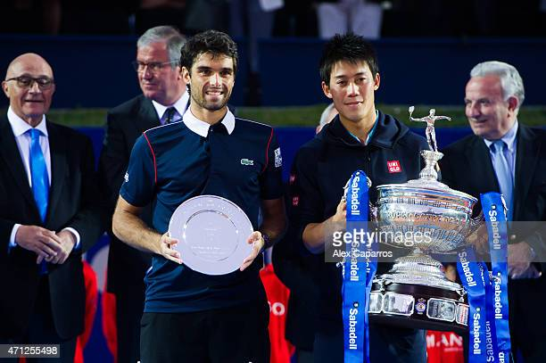 Kei Nishikori of Japan poses with the Barcelona Open Banc Sabadell trophy after defeating Pablo Andujar of Spain on their final match during day...