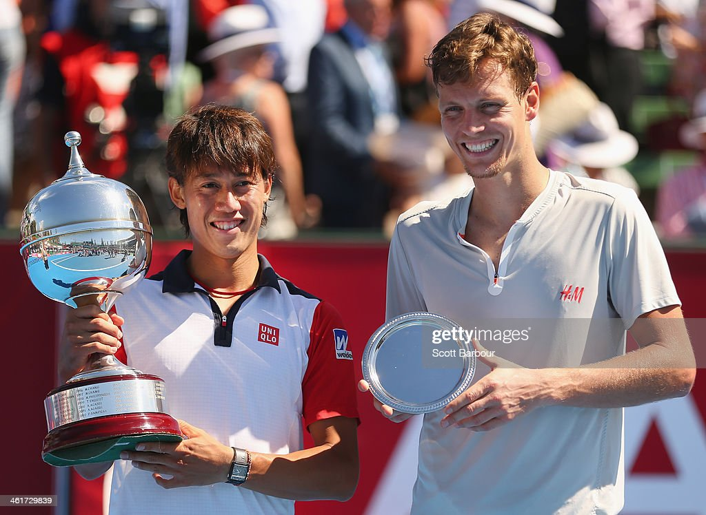 Kei Nishikori of Japan poses with the Kooyong Classic trophy after winning his match against Tomas Berdych of the Czech Republic in the final during...