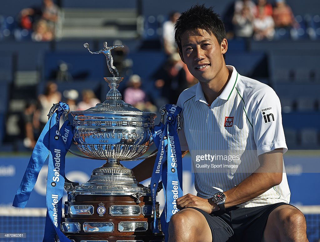Kei Nishikori of Japan poses with the trophy after day eight of the ATP Barcelona Open Banc Sabadell at the Real Club de Tenis Barcelona on April 27, 2014 in Barcelona, Spain.