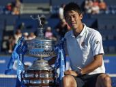 Kei Nishikori of Japan poses with the trophy after day eight of the ATP Barcelona Open Banc Sabadell at the Real Club de Tenis Barcelona on April 27...