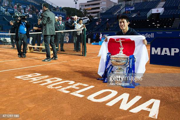Kei Nishikori of Japan poses with the trophy of the Barcelona Open Banc Sabadell after defeating Pablo Andujar of Spain on the final match during day...