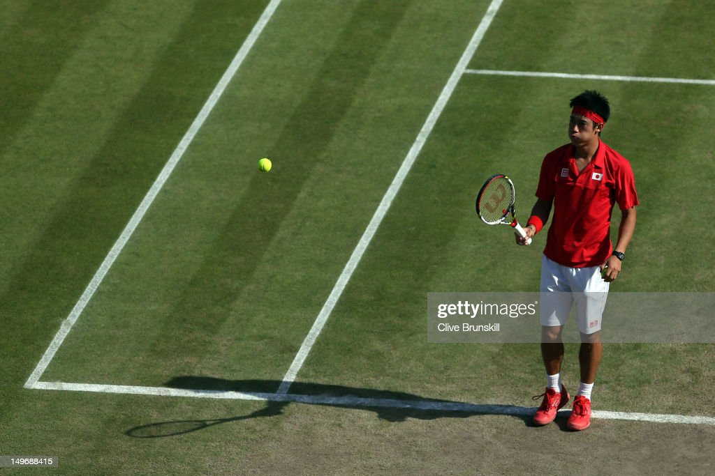 <a gi-track='captionPersonalityLinkClicked' href=/galleries/search?phrase=Kei+Nishikori&family=editorial&specificpeople=4432498 ng-click='$event.stopPropagation()'>Kei Nishikori</a> of Japan reacts after a point to Juan Martin Del Potro of Argentina during the Quarterfinal of Men's Singles Tennis on Day 6 of the London 2012 Olympic Games at Wimbledon on August 2, 2012 in London, England.